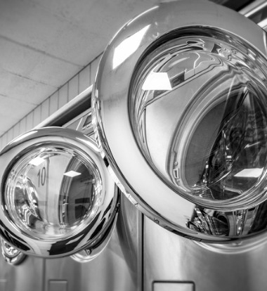 Open Industrial Laundry Equipment in black and white