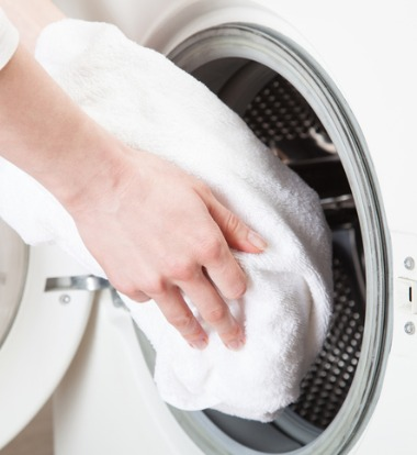 Hands Loading Commercial Washer and Dryer in Bloomington IL