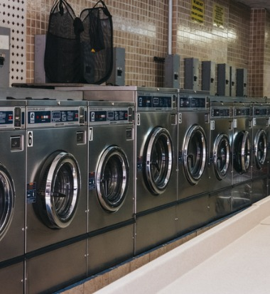 A row of Industrial Washing Machines in Kansas City MO at a laundromat