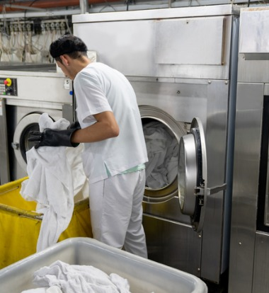An employee loading Industrial Washing Machines in South Bend IN